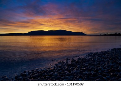 Orcas Island Sunset. A beautiful and dramatic sunset over Orcas Island in the San Juan Islands of Puget Sound in western Washington State, USA.