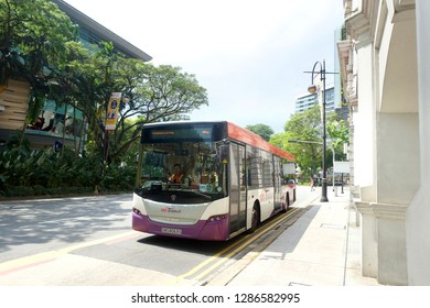 Orchard Road, Singapore - January 12, 2019 : View of a SBS (Singapore Bus Transit) bus arriving at a bus station at Bras Basah