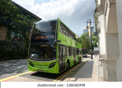 Orchard Road, Singapore - January 12, 2019 : View of a SBS (Singapore Bus Transit) double decker bus arriving at a bus station at Bras Basah