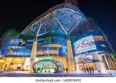 ORCHARD ROAD, SINGAPORE - JANUARY 6, 2019 : Singapore night city skyline at ION Orchard shopping mall