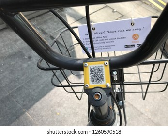 Orchard, Singapore - August 20, 2017: Handlebar of a stationless obike ride sharing or rent bicycle with QR code link.