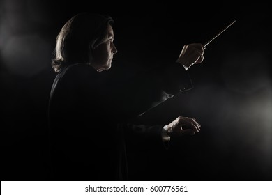 Orchestra conductor music conducting with baton Maestro hands with stick Symphony orchestra concert