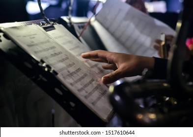 Orchestra music stands. Performance on the stage of a brass symphony orchestra. musician reads musical notes.