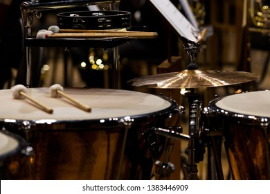 Orchestral percussion instruments in dark colors close-up