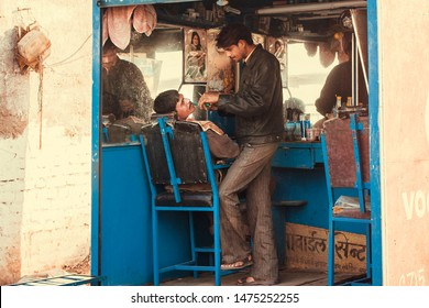 ORCHHA, INDIA: Indian village professional hairdresser salon on street for poor people on December 21, 2018. Madhya Pradesh is the second largest Indian state by area.