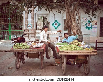Orchha, Madhya Pradesh, India - November 30, 2018: Portrait of unidentified Indian mans on streets market with fruits. Daily lifestyle in rural area central India.