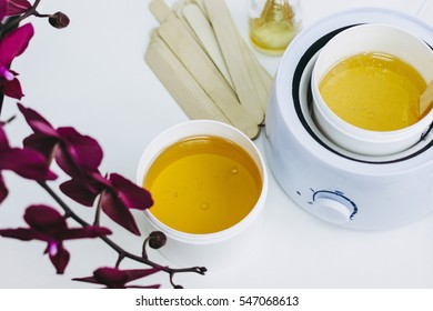 Orchid flower, aromatic sticks and paste for sugaring in beauty salon