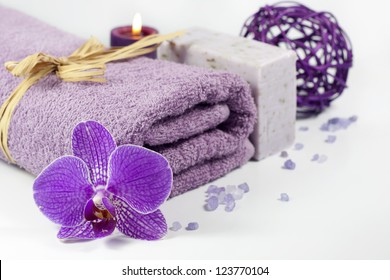 Orchid and towel spa concept with bath salt