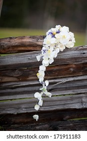 Orchid wedding bouquet on old wooden background