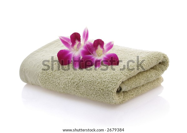 Orchids on Green Towel