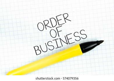 ORDER OF BUSINESS concept write text on notebook