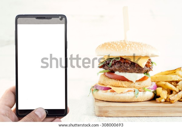 Order food concept with blank screen on smart phone and beef burger