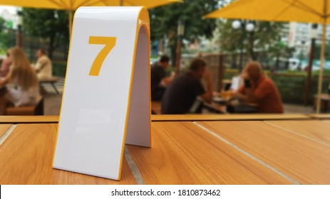 the order number on the table on the street in a McDonald's restaurant. Awaiting an order at a McDonald's restaurant. Fast food with invoice, check. Ukraine, Kiev - September 6, 2019.