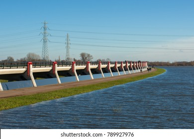 In order to prevent flooding elsewhere on undesired locations, it is the local area of the dike reduced or concrete flood defenses, delta works built to control the flooding water.