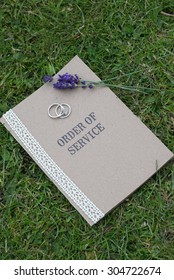 Order of Service, with wedding rings and lavender