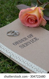 Order of Service, with wedding rings and rose