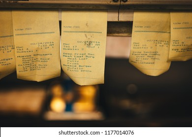 Order Tickets Hanging In The Kitchen Of A Vintage Diner
