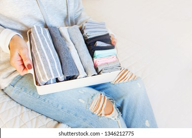Order in wardrobe. Clothing neatly folded