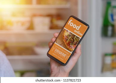 Ordering food online with smart phone at home