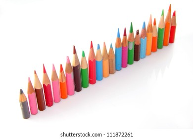 Orderly row  of short pencils of different colors
