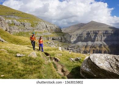 Ordesa & Monte Perdido National Park in Spain, Europe on a sunny day of summer / autumn - Couple hiking on Faja de las Flores