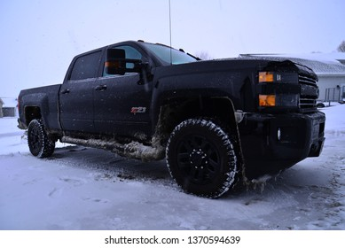 Ordfordville, Wisconsin / USA - February 17, 2019: 2019 Chevrolet Silverado 2500HD LTZ Midnight Edition Duramax  after a long winter drive on a very stormy day.