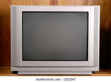 Ordinary and commonplace 27 inch flatscreen television in a wood enclosure cabinet