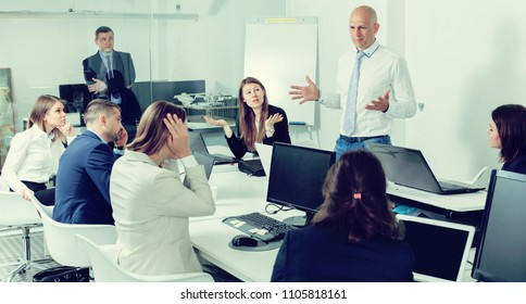 Ordinary manager expressing dissatisfaction with teamwork of colleagues at meeting