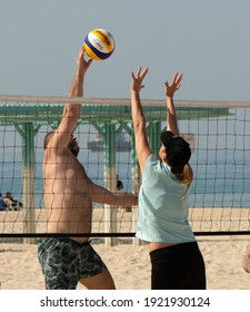 Ordinary people of all ages gathered to play volleyball on the city beach. Israel Ashkelon February 2021
