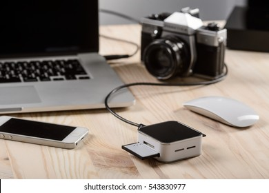 Media card reader images stock photos vectors shutterstock an ordinary workplace of a photographer a vintage camera a card reader connected to publicscrutiny Image collections