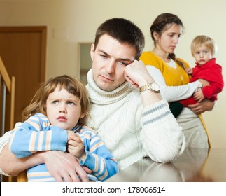 Ordinary young  family of four after quarrel in home