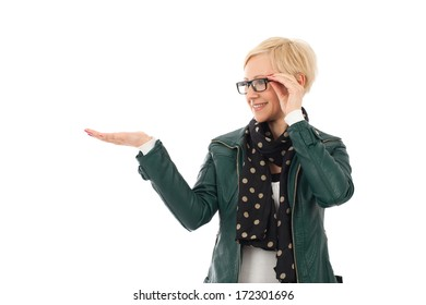 Ordinary young woman in casual outfit holding empty palm with copyspace