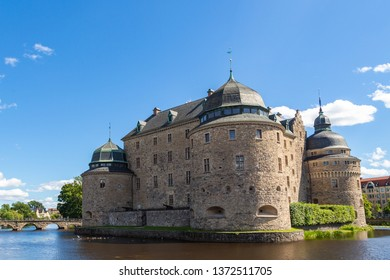 Orebro Castle. The medieval castle fortification in Orebro, Narke, Sweden. Orebro Castle at sunny summer day. Tourism holidays and travel. Tourist attractions in Sweden.