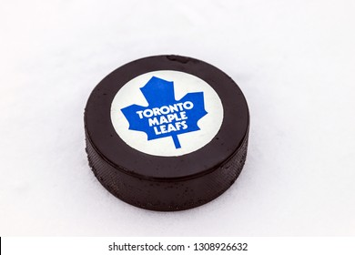 OREBRO, SWEDEN - FEBRUARY 3, 2019: Toronto Maple Leafs logo on Ice hockey puck outdoors in snow