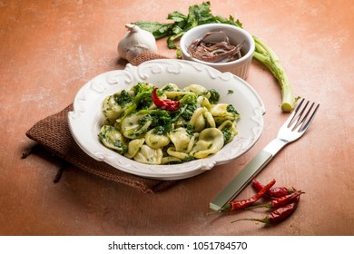 orecchiette with turnip top and anchovies, traditional italian recipe