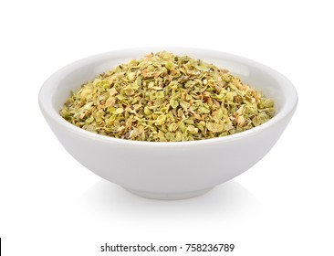 Oregano spice in a bowl on white background