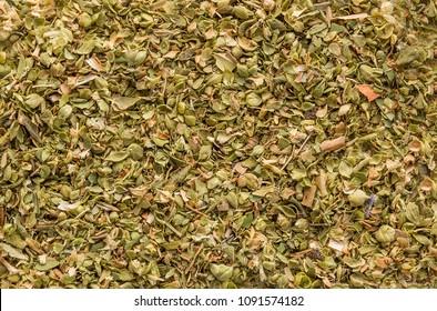 Oregano spice detail macro texture background pattern. Spilled oregano spice macro.