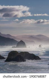 An Oregon beach with a veil of sea mist.