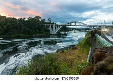 The Oregon City Bridge, also known as the Arch Bridge, is a steel through arch bridge spanning the Willamette River between Oregon City and West Linn, Oregon, USA