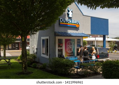 Oregon City, Oregon - May 30, 2019: Customers at a Dutch Bros Coffee franchise on a warm sunny day. Dutch Bros Coffee is the largest privately held drive-through coffee chain in the United States.