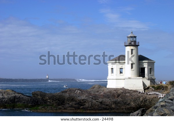 oregon light house along the oregon coast with a blue sky and ocean background
