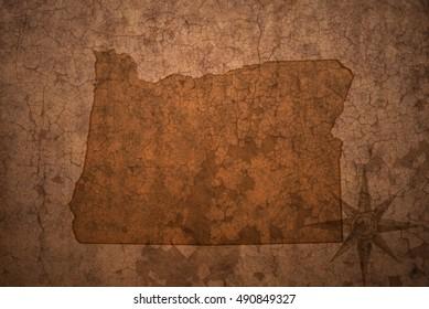 oregon state map on a old vintage crack paper background