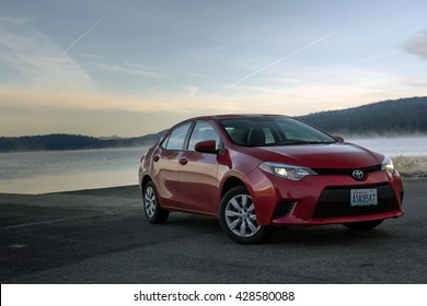 Oregon, USA - Nov 12, 2015: Red car Toyota Corolla near lake early morning, Nov 12, 2015 Oregon, US