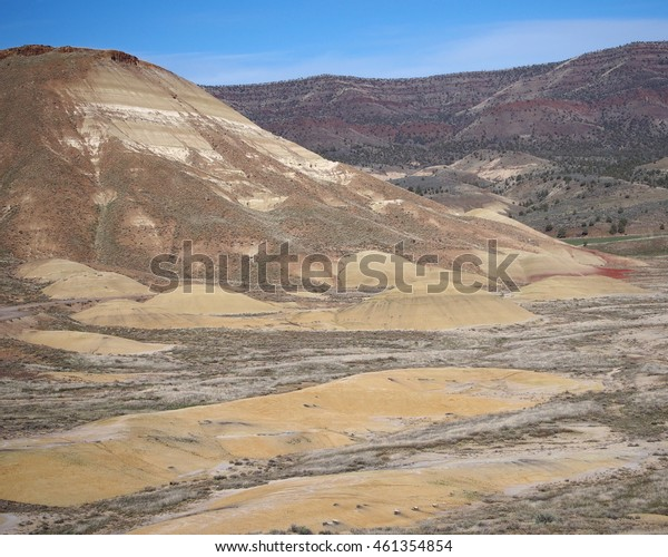 Oregon's Painted Hills stand with all of the contrast they offer on a nice spring day.