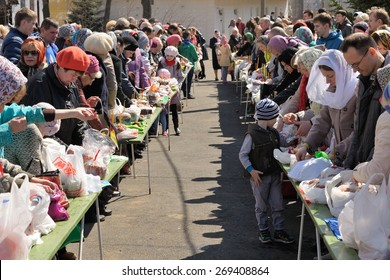 Orel, Russia, April 11, 2015: Traditional ortodox paschal ritual - people stand in a row waiting for blessing easter eggs and kulitches with holy water horizontal