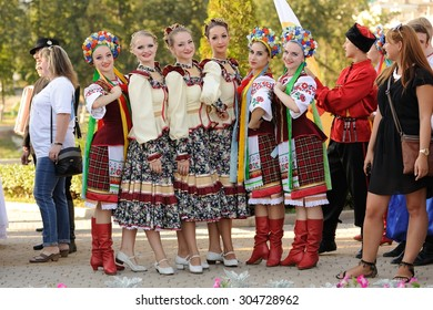 Orel, Russia, August 4, 2015: Orlovskaya Mozaika folk festival, man and women in traditional Cossack suits standing in row