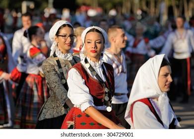 Orel, Russia, August 4, 2015: Orlovskaya Mozaika folk festival, women in traditional Serbian suits in round dance