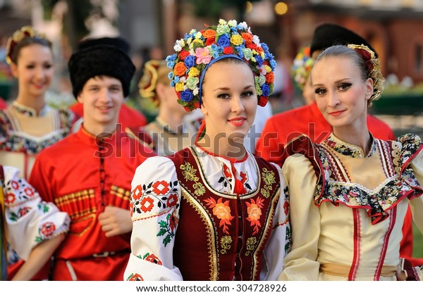 Orel, Russia, August 4, 2015: Orlovskaya Mozaika folk festival, young women in Kuban traditional dress smiling