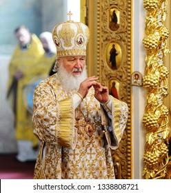 Orel, Russia, July 28, 2016: Russia Christianization anniversary Divine Liturgy. Patriarch Kirill praying in golden robe in church