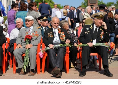 Orel, Russia - May 9, 2016: Celebration of 71th anniversary of the Victory Day (WWII). Russian war veterans sitting in bright sun